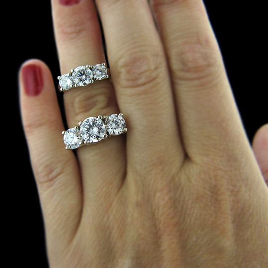 Three Stone Engagement Ring On Hand