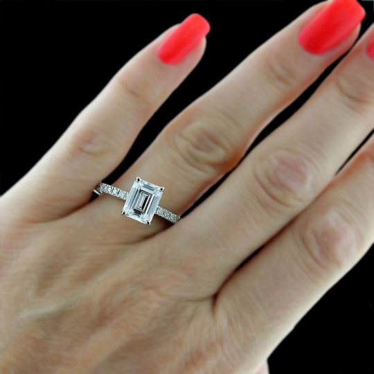 Emerald cut diamond engagement rings on hand