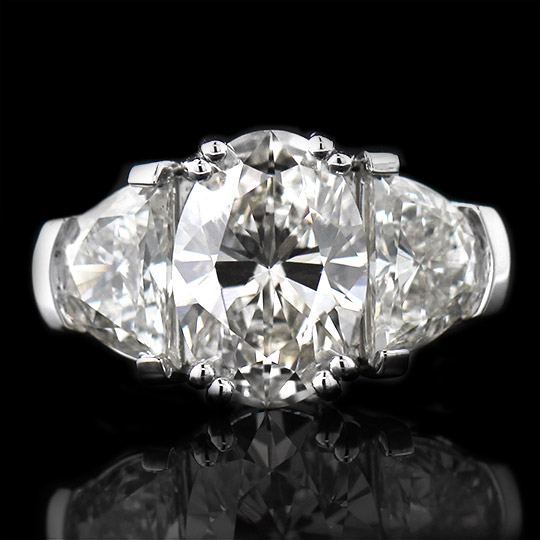 Custom Three Stone Ring with a 3.01ct Oval Cut LCD.
